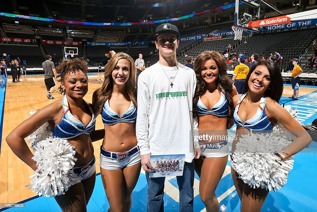 Cody Metz, center, in attendance through the Make-A-Wish Foundation, poses for a picture with the Oklahoma City Thunder Girls before a game between the Minnesota Timberwolves and Thunder on January 9, 2013 at the Chesapeake Energy Arena in Oklahoma City, Oklahoma.