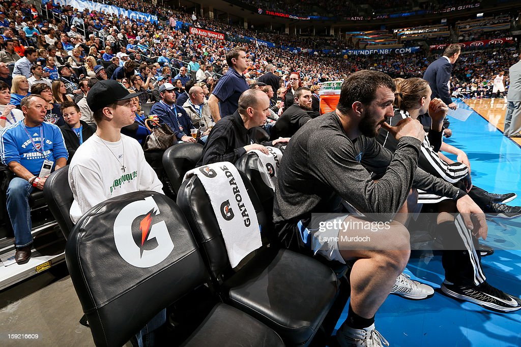 Cody Metz, in attendance through the Make-A-Wish Foundation, left, sits behind the Minnesota Timberwolves bench during a game against the Oklahoma City Thunder on January 9, 2013 at the Chesapeake Energy Arena in Oklahoma City, Oklahoma.