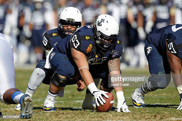 Cody Peterson of the Navy Midshipmen snaps the ball to Keenan Reynolds during a game against the Middle Tennessee Blue Raiders during the Bell...