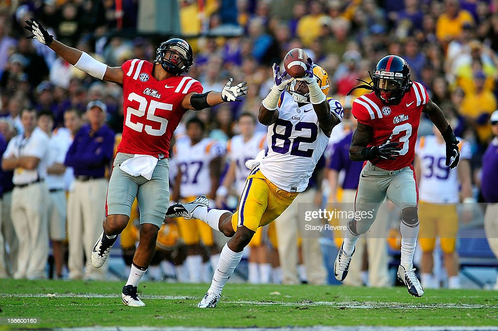 Cody Prewitt #25 and Charles Sawyer #3 of the Ole Miss Rebels are unable to defend a pass caught by James Wright #82 of the LSU Tigers during a game at Tiger Stadium on November 17, 2012 in Baton Rouge, Louisiana.