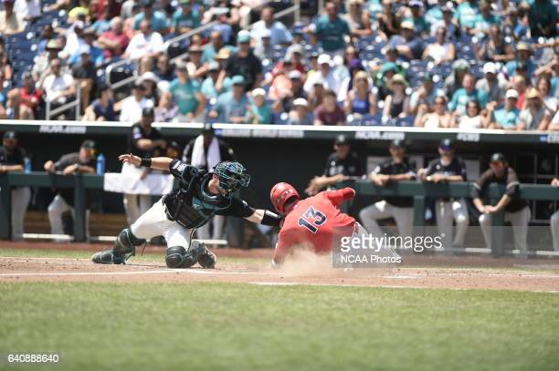Cody Ramer of the University of Arizona is out at a play at the plate against Coastal Carolina University during Game 3 of the Division I Men's...