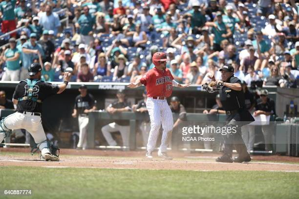 Cody Ramer of the University of Arizona reacts to the call at the plate after being called out against Coastal Carolina University during Game 3 of...