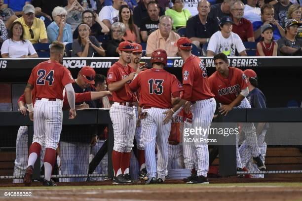 Cody Ramer of University of Arizona scores the tying run against Coastal Carolina University during the Division I Men's Baseball Championship held...