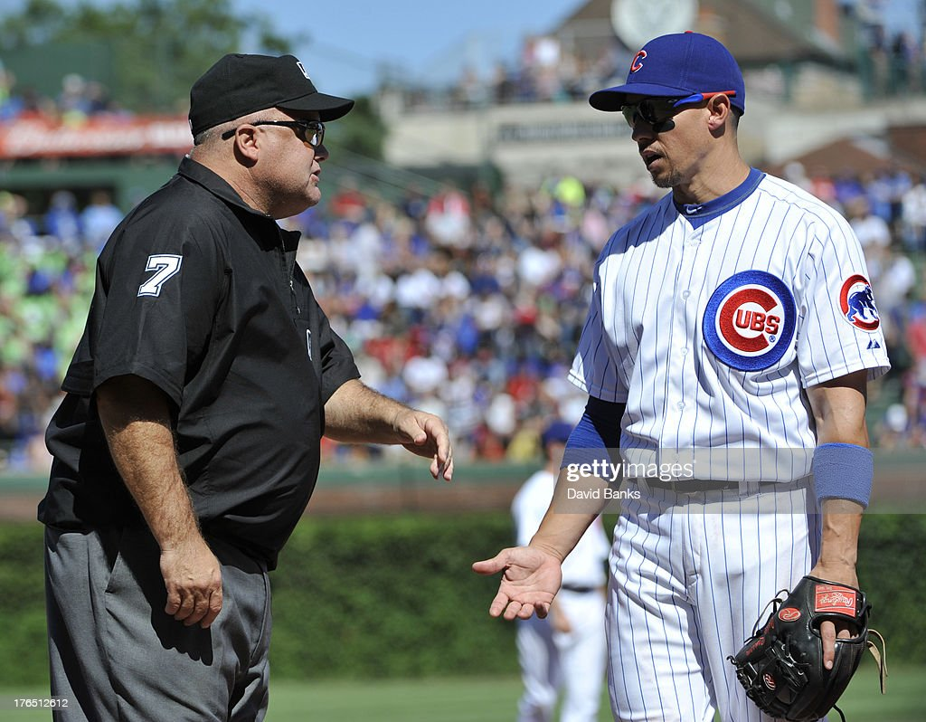 <a gi-track='captionPersonalityLinkClicked' href=/galleries/search?phrase=Cody+Ransom&family=editorial&specificpeople=239159 ng-click='$event.stopPropagation()'>Cody Ransom</a> #1 of the Chicago Cubs argues a play with umpire <a gi-track='captionPersonalityLinkClicked' href=/galleries/search?phrase=Brian+O%27Nora&family=editorial&specificpeople=545809 ng-click='$event.stopPropagation()'>Brian O'Nora</a> #7 during the seventh inning on August 14, 2013 at Wrigley Field in Chicago, Illinois.