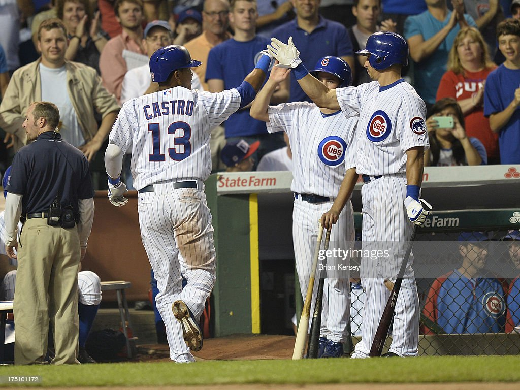 Cody Ransom #1 of the Chicago Cubs (R) high fives teammate Starlin Castro #13 after he hit a solo home run during the fourth inning against the Milwaukee Brewers at Wrigley Field on July 31, 2013 in Chicago, Illinois.