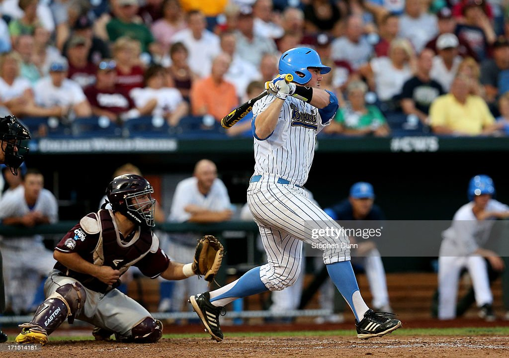 Cody Regis #18 of the UCLA Bruins hits an RBI single in the fourth inning against the Mississippi State Bulldogs during game two of the College World Series Finals on June 25, 2013 at TD Ameritrade Park in Omaha, Nebraska.