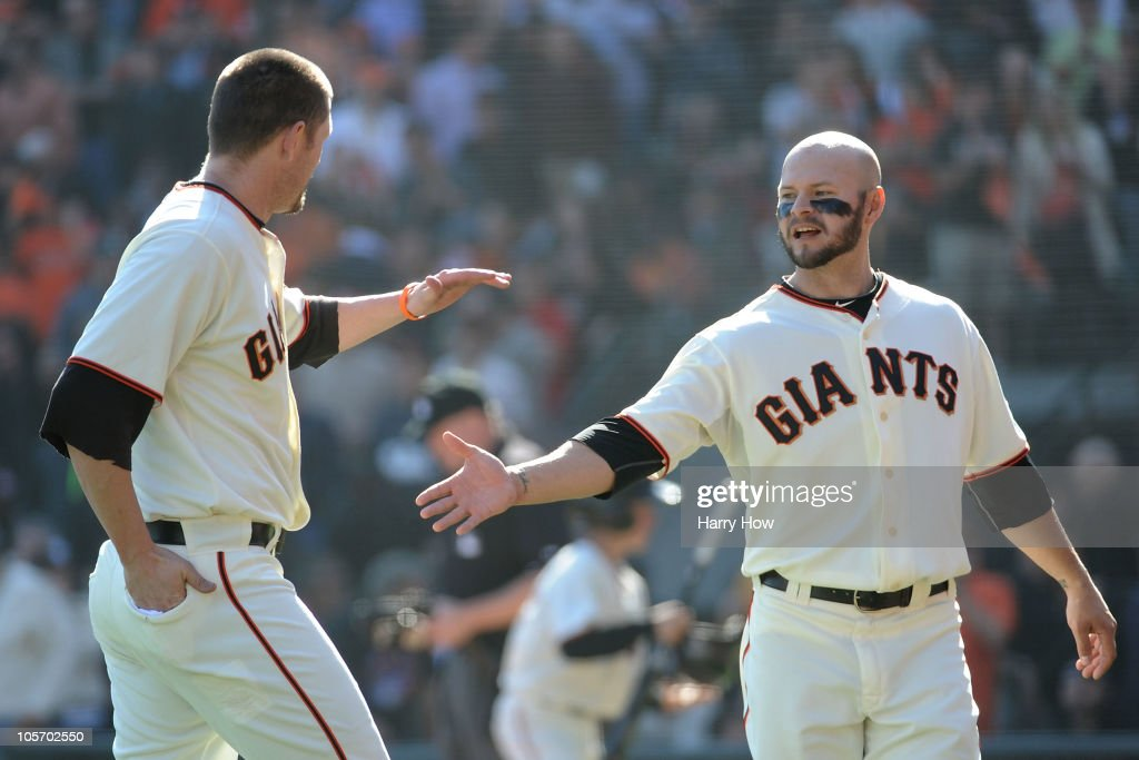 <a gi-track='captionPersonalityLinkClicked' href=/galleries/search?phrase=Cody+Ross&family=editorial&specificpeople=545810 ng-click='$event.stopPropagation()'>Cody Ross</a> #13 and <a gi-track='captionPersonalityLinkClicked' href=/galleries/search?phrase=Aubrey+Huff&family=editorial&specificpeople=208964 ng-click='$event.stopPropagation()'>Aubrey Huff</a> #17 of the San Francisco Giants celebrate a two run fourth inning against the Philadelphia Phillies in Game Three of the NLCS during the 2010 MLB Playoffs at AT&T Park on October 19, 2010 in San Francisco, California.