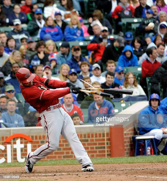 Cody Ross of the Arizona Diamondbacks breaks his bat and flies out against the Chicago Cubs during the fifth inning on June 2 2013 at Wrigley Field...