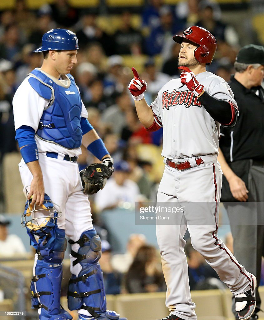 <a gi-track='captionPersonalityLinkClicked' href=/galleries/search?phrase=Cody+Ross&family=editorial&specificpeople=545810 ng-click='$event.stopPropagation()'>Cody Ross</a> #7 of the Arizona Diamondbacks celebrates as he crosses home plate after his solo home run in the fifth inning past catcher A.J. Ellis #17 of the Los Angeles Dodgers at Dodger Stadium on May 6, 2013 in Los Angeles, California.