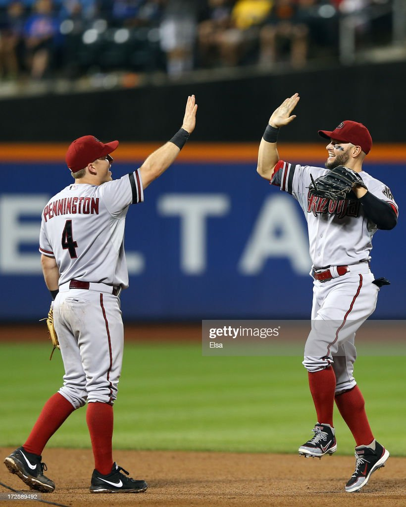 <a gi-track='captionPersonalityLinkClicked' href=/galleries/search?phrase=Cody+Ross&family=editorial&specificpeople=545810 ng-click='$event.stopPropagation()'>Cody Ross</a> #7 of the Arizona Diamondbacks celebrates the win with teammate Cliff Pennington #4 after the game against the New York Mets on July 3, 2013 at Citi Field in the Flushing neighborhood of the Queens borough of New York City. The Arizona Diamondbacks defeated the New York Mets 5-2.
