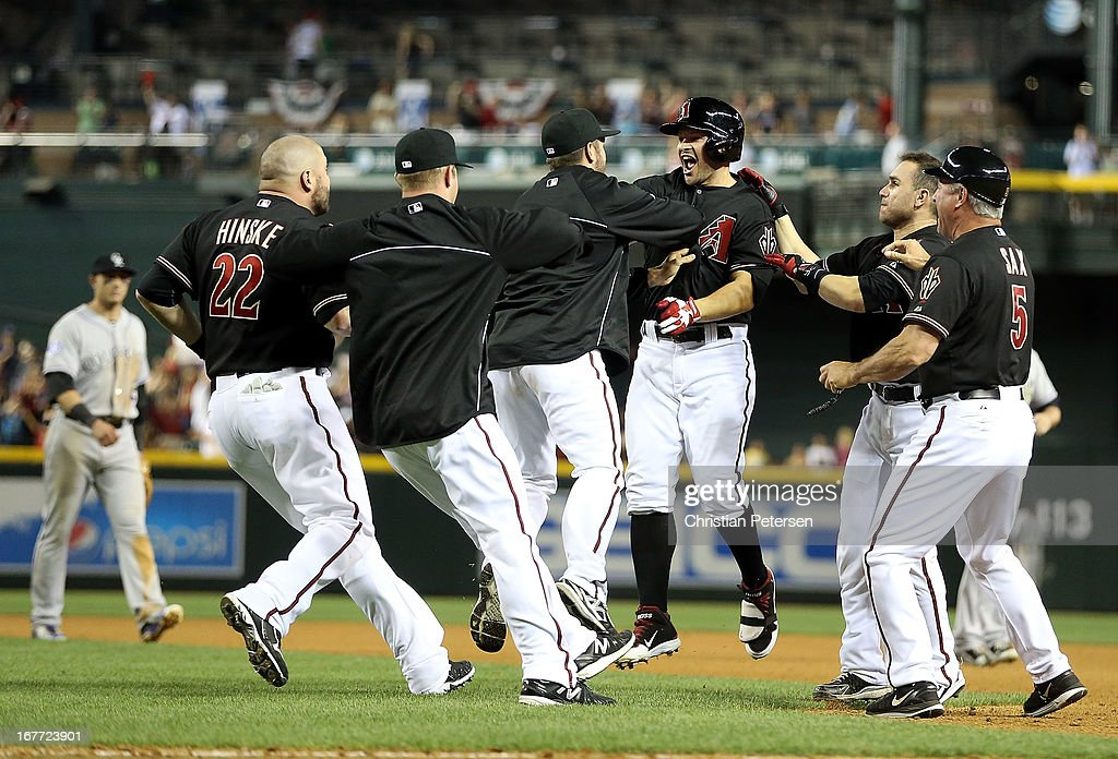 <a gi-track='captionPersonalityLinkClicked' href=/galleries/search?phrase=Cody+Ross&family=editorial&specificpeople=545810 ng-click='$event.stopPropagation()'>Cody Ross</a> #7 (third from right) of the Arizona Diamondbacks celebrates with Adam Eaton #6 after hitting a walk off sacrifice fly to defeat the Colorado Rockies 3-2 in the 10th inning of the MLB game at Chase Field on April 27, 2013 in Phoenix, Arizona.