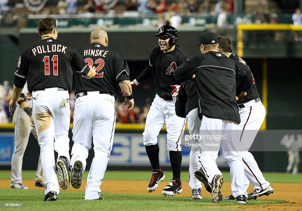 <a gi-track='captionPersonalityLinkClicked' href=/galleries/search?phrase=Cody+Ross&family=editorial&specificpeople=545810 ng-click='$event.stopPropagation()'>Cody Ross</a> #7 (C) of the Arizona Diamondbacks celebrates with Eric Hinske #22 and A.J. Pollock #11 after hitting a walk off sacrifice fly to defeat the Colorado Rockies 3-2 in the 10th inning of the MLB game at Chase Field on April 27, 2013 in Phoenix, Arizona.