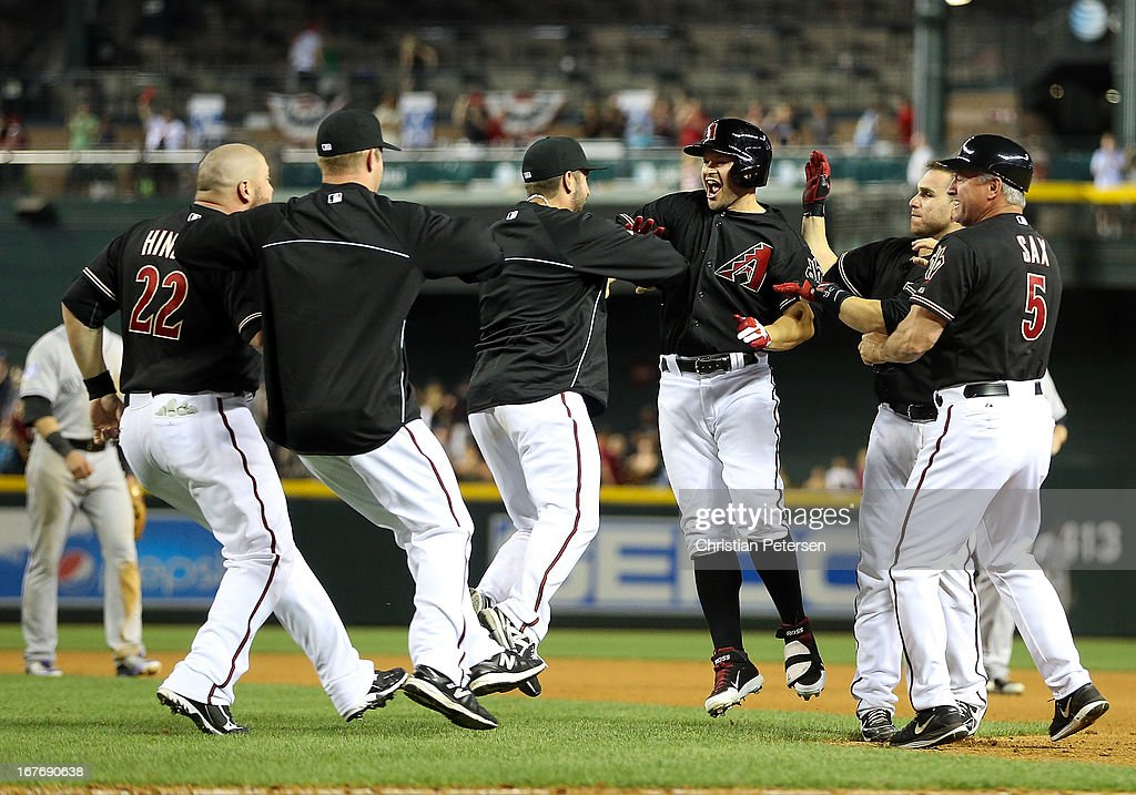 <a gi-track='captionPersonalityLinkClicked' href=/galleries/search?phrase=Cody+Ross&family=editorial&specificpeople=545810 ng-click='$event.stopPropagation()'>Cody Ross</a> #7 (third from right) of the Arizona Diamondbacks celebrates with teammates after hitting a walk off sacrifice fly to defeat the Colorado Rockies 3-2 in the 10th inning of the MLB game at Chase Field on April 27, 2013 in Phoenix, Arizona.