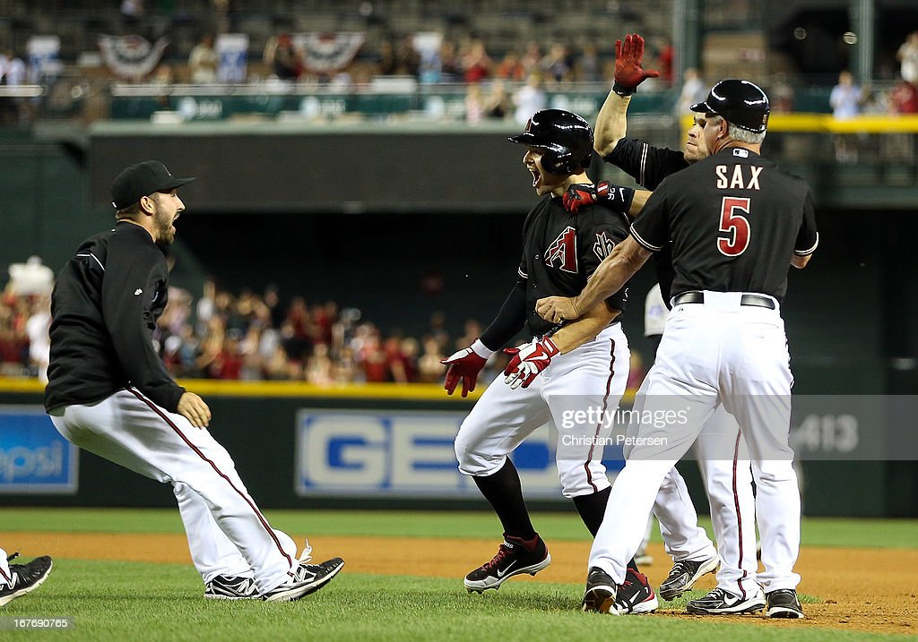 <a gi-track='captionPersonalityLinkClicked' href=/galleries/search?phrase=Cody+Ross&family=editorial&specificpeople=545810 ng-click='$event.stopPropagation()'>Cody Ross</a> #7 of the Arizona Diamondbacks celebrates with teammates after hitting a walk off sacrifice fly to defeat the Colorado Rockies 3-2 in the 10th inning of the MLB game at Chase Field on April 27, 2013 in Phoenix, Arizona.