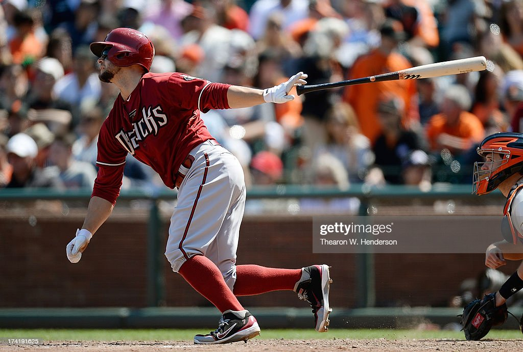 <a gi-track='captionPersonalityLinkClicked' href=/galleries/search?phrase=Cody+Ross&family=editorial&specificpeople=545810 ng-click='$event.stopPropagation()'>Cody Ross</a> #7 of the Arizona Diamondbacks hits a bases loaded two-run single scoring Martin Prado #14 and Paul Goldschmidt #44 in the eighth inning against the San Francisco Giants at AT&T Park on July 21, 2013 in San Francisco, California.