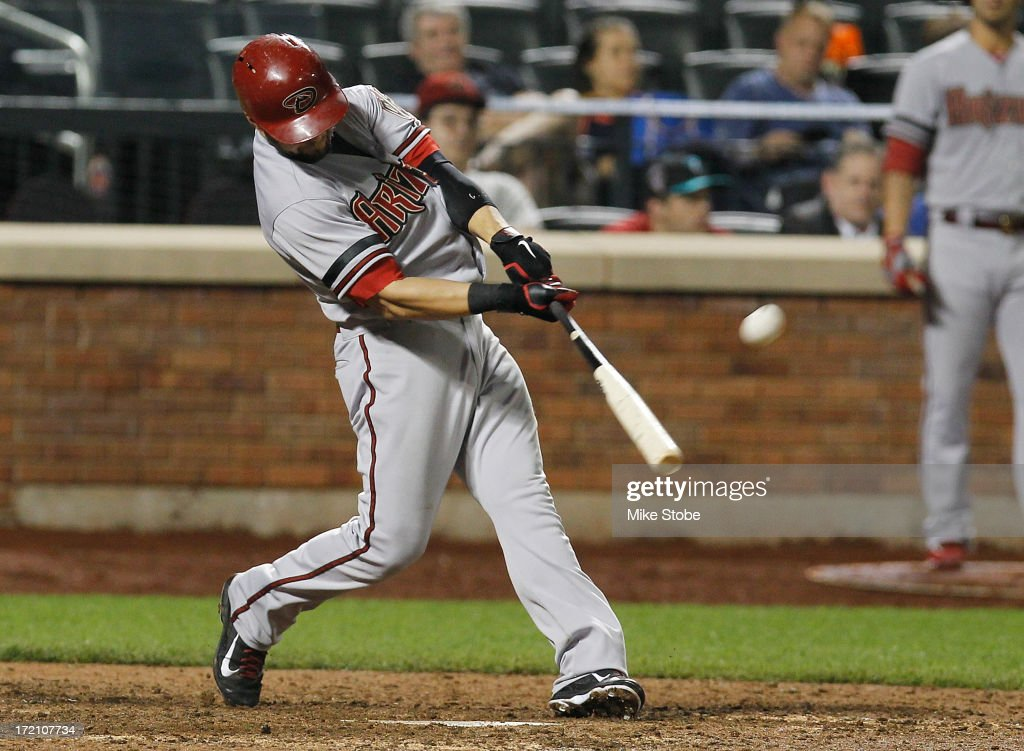 <a gi-track='captionPersonalityLinkClicked' href=/galleries/search?phrase=Cody+Ross&family=editorial&specificpeople=545810 ng-click='$event.stopPropagation()'>Cody Ross</a> #7 of the Arizona Diamondbacks hits a solo home run in the thirteenth inning against the New York Mets at Citi Field on July 1, 2013 at Citi Field in the Flushing neighborhood of the Queens borough of New York City.