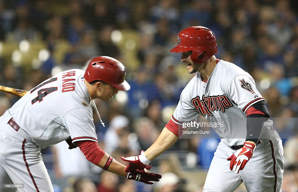 <a gi-track='captionPersonalityLinkClicked' href=/galleries/search?phrase=Cody+Ross&family=editorial&specificpeople=545810 ng-click='$event.stopPropagation()'>Cody Ross</a> #7 of the Arizona Diamondbacks is greeted by <a gi-track='captionPersonalityLinkClicked' href=/galleries/search?phrase=Martin+Prado&family=editorial&specificpeople=620159 ng-click='$event.stopPropagation()'>Martin Prado</a> #14 after Ross' solo home run in the fifth inning against the Los Angeles Dodgers at Dodger Stadium on May 6, 2013 in Los Angeles, California.