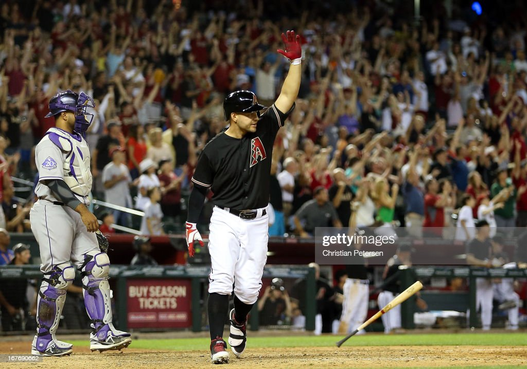 <a gi-track='captionPersonalityLinkClicked' href=/galleries/search?phrase=Cody+Ross&family=editorial&specificpeople=545810 ng-click='$event.stopPropagation()'>Cody Ross</a> #7 of the Arizona Diamondbacks reacts after hitting a walk off sacrifice fly to defeat the Colorado Rockies 3-2 in the 10th inning of the MLB game at Chase Field on April 27, 2013 in Phoenix, Arizona.