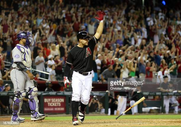 Cody Ross of the Arizona Diamondbacks reacts after hitting a walk off sacrifice fly to defeat the Colorado Rockies 32 in the 10th inning of the MLB...