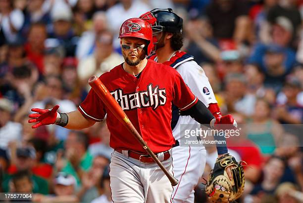 Cody Ross of the Arizona Diamondbacks reacts after striking out against the Boston Red Sox during the game on August 4 2013 at Fenway Park in Boston...