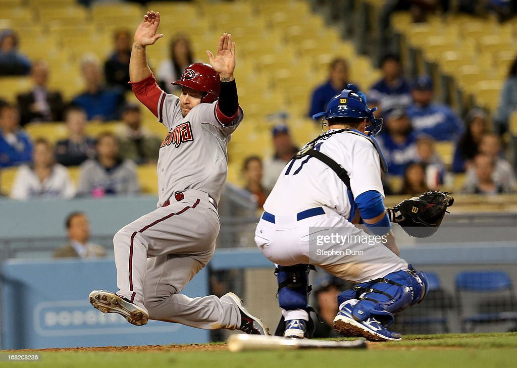 <a gi-track='captionPersonalityLinkClicked' href=/galleries/search?phrase=Cody+Ross&family=editorial&specificpeople=545810 ng-click='$event.stopPropagation()'>Cody Ross</a> #7 of the Arizona Diamondbacks slides past catcher A.J. Ellis #17 of the Los Angeles Dodgers to score a run in the ninth inning at Dodger Stadium on May 6, 2013 in Los Angeles, California.