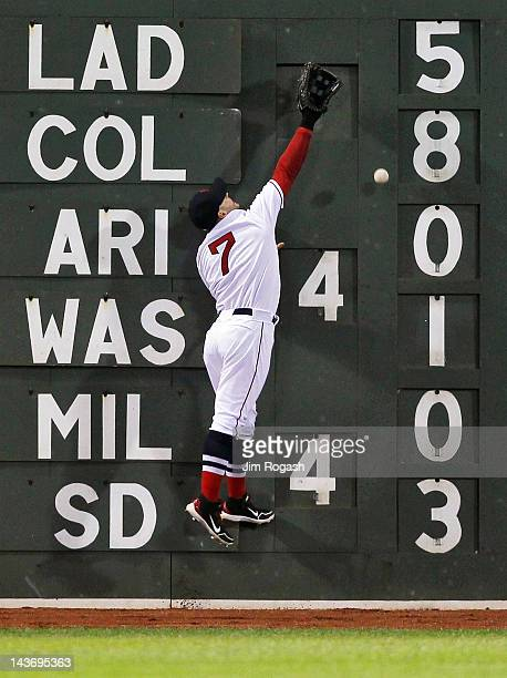 Cody Ross of the Boston Red Sox comes up short on a ball hit by the Oakland Athletics at Fenway Park May 2 2012 in Boston Massachusetts
