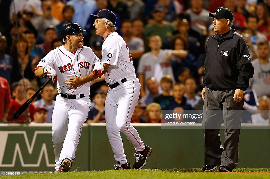 <a gi-track='captionPersonalityLinkClicked' href=/galleries/search?phrase=Cody+Ross&family=editorial&specificpeople=545810 ng-click='$event.stopPropagation()'>Cody Ross</a> #7 of the Boston Red Sox is restrained by manager <a gi-track='captionPersonalityLinkClicked' href=/galleries/search?phrase=Bobby+Valentine&family=editorial&specificpeople=214135 ng-click='$event.stopPropagation()'>Bobby Valentine</a> #25 while arguing a called three strike with home plate umpire Alfonso Marquez after being thrown out of the game against the New York Yankees during the game on September 12, 2012 at Fenway Park in Boston, Massachusetts.