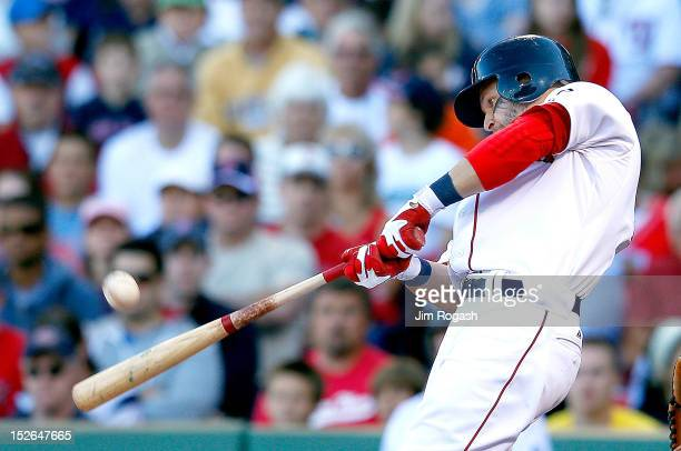 Cody Ross of the Boston Red Sox knocks in the winning run in the 8th inning against the Baltimore Orioles at Fenway Park on September 23 2012 in...