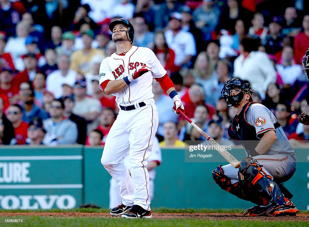 <a gi-track='captionPersonalityLinkClicked' href=/galleries/search?phrase=Cody+Ross&family=editorial&specificpeople=545810 ng-click='$event.stopPropagation()'>Cody Ross</a> #7 of the Boston Red Sox knocks in the winning run in the 8th inning as <a gi-track='captionPersonalityLinkClicked' href=/galleries/search?phrase=Matt+Wieters&family=editorial&specificpeople=4498276 ng-click='$event.stopPropagation()'>Matt Wieters</a> #32 of the Baltimore Orioles looks on at Fenway Park on September 23, 2012 in Boston, Massachusetts.