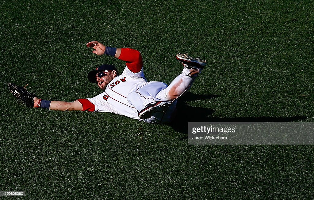 <a gi-track='captionPersonalityLinkClicked' href=/galleries/search?phrase=Cody+Ross&family=editorial&specificpeople=545810 ng-click='$event.stopPropagation()'>Cody Ross</a> #7 of the Boston Red Sox makes a catch in right field against the Kansas City Royals during the game on August 26, 2012 at Fenway Park in Boston, Massachusetts.