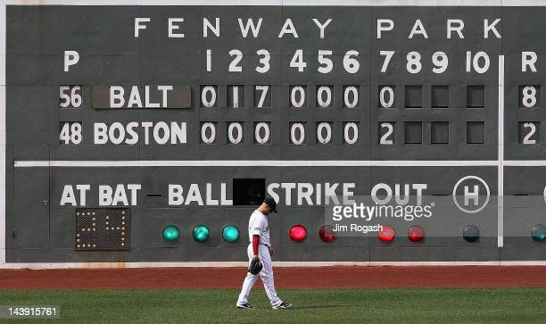 Cody Ross of the Boston Red Sox paces the outfield against the Baltimore Orioles in the eighth inning at Fenway Park May 5 2012 in Boston...