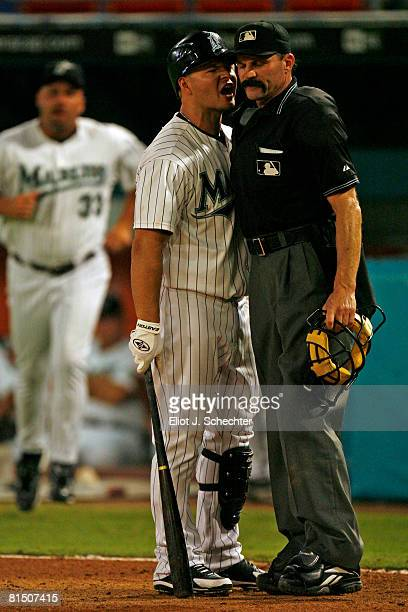 Cody Ross of the Florida Marlins argues with Home Plate Umpire Bill Hohn and gets tossed from the game in the 8th inning against the Cincinnati Reds...