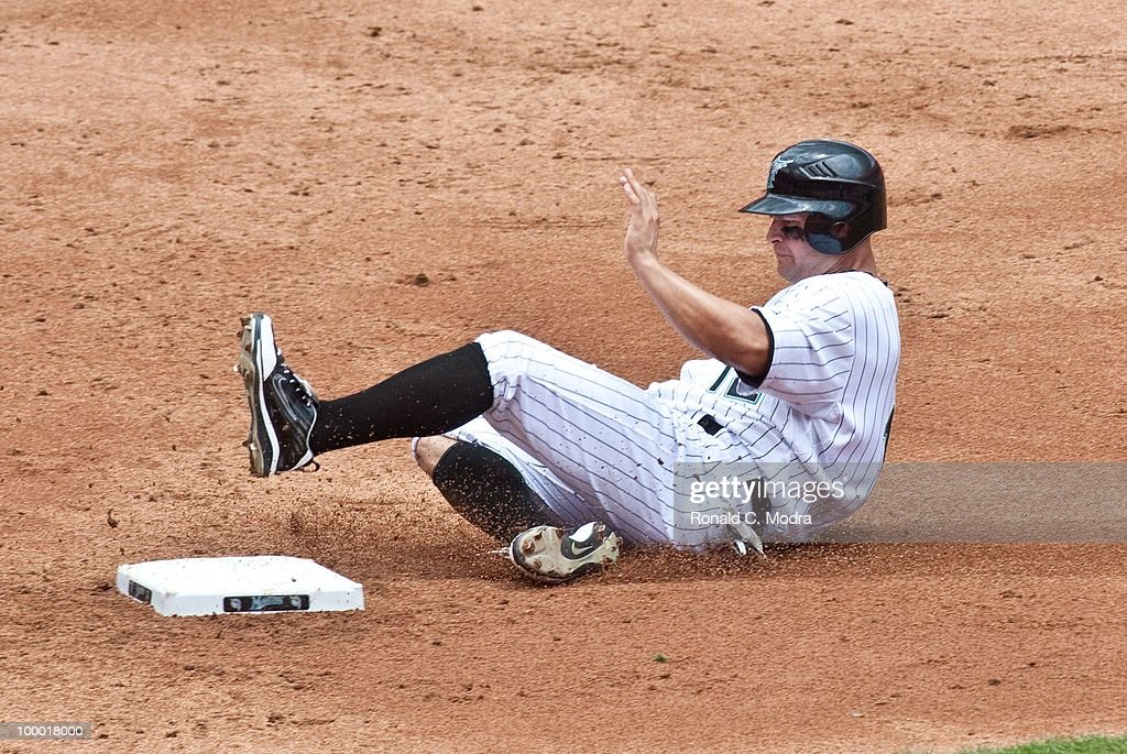 Cody Ross #12 of the Florida Marlins slides into second base during a MLB game against the Arizona Diamondbacks in Sun Life Stadium on May 18, 2010 in Miami, Florida.