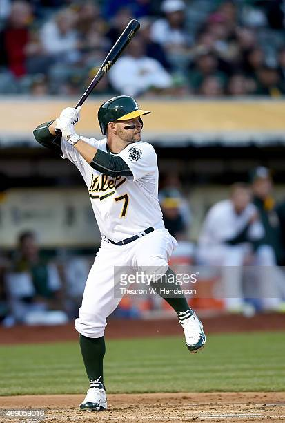 Cody Ross of the Oakland Athletics bats against the Texas Rangers in the bottom of the first inning at Oco Coliseum on April 8 2015 in Oakland...