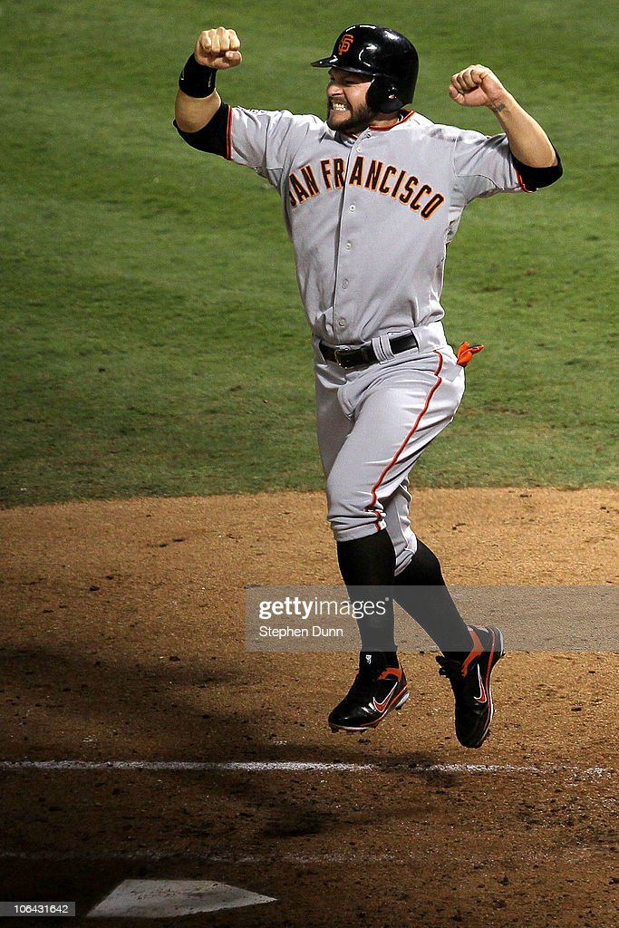 <a gi-track='captionPersonalityLinkClicked' href=/galleries/search?phrase=Cody+Ross&family=editorial&specificpeople=545810 ng-click='$event.stopPropagation()'>Cody Ross</a> #13 of the San Francisco Giants celebrates after he scored on a 3-run home run hit by Edgar Renteria #16 in the seventh inning against the Texas Rangers in Game Five of the 2010 MLB World Series at Rangers Ballpark in Arlington on November 1, 2010 in Arlington, Texas.