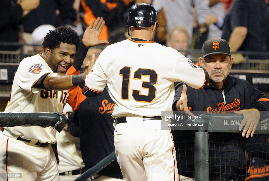 <a gi-track='captionPersonalityLinkClicked' href=/galleries/search?phrase=Cody+Ross&family=editorial&specificpeople=545810 ng-click='$event.stopPropagation()'>Cody Ross</a> #13 of the San Francisco Giants celebrates with <a gi-track='captionPersonalityLinkClicked' href=/galleries/search?phrase=Pablo+Sandoval&family=editorial&specificpeople=803207 ng-click='$event.stopPropagation()'>Pablo Sandoval</a> #48 and manager <a gi-track='captionPersonalityLinkClicked' href=/galleries/search?phrase=Bruce+Bochy&family=editorial&specificpeople=220291 ng-click='$event.stopPropagation()'>Bruce Bochy</a> #15 after he scored on an RBI single by Brandon Crawford against the Los Angeles Dodgers in the sixth inning during an MLB baseball game at AT&T Park July 18, 2011 in San Francisco, California. The Giants won the game 5-0.