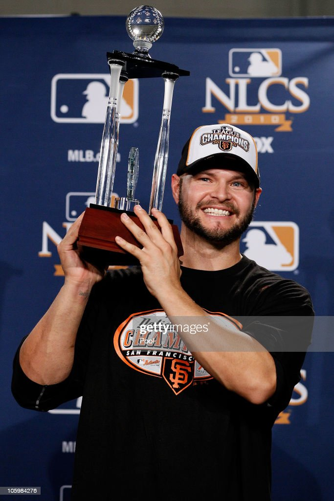 <a gi-track='captionPersonalityLinkClicked' href=/galleries/search?phrase=Cody+Ross&family=editorial&specificpeople=545810 ng-click='$event.stopPropagation()'>Cody Ross</a> #13 of the San Francisco Giants celebrates with the NCLS MVP trophy after defeating the Philadelphia Phillies 3-2 and winning the pennant in Game Six of the NLCS during the 2010 MLB Playoffs at Citizens Bank Park on October 23, 2010 in Philadelphia, Pennsylvania.