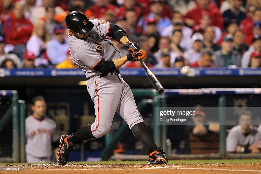 <a gi-track='captionPersonalityLinkClicked' href=/galleries/search?phrase=Cody+Ross&family=editorial&specificpeople=545810 ng-click='$event.stopPropagation()'>Cody Ross</a> #13 of the San Francisco Giants hits a solo home run in the fifth inning against the Philadelphia Phillies in Game Two of the NLCS during the 2010 MLB Playoffs at Citizens Bank Park on October 17, 2010 in Philadelphia, Pennsylvania.