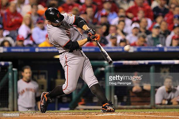 Cody Ross of the San Francisco Giants hits a solo home run in the fifth inning against the Philadelphia Phillies in Game Two of the NLCS during the...