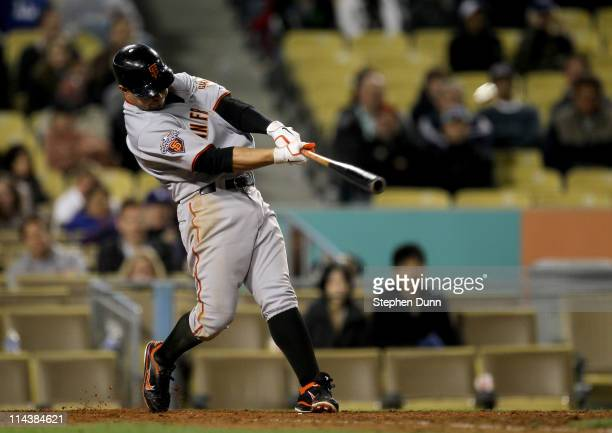 Cody Ross of the San Francisco Giants hits a three run home run in the ninth inning against the Los Angeles Dodgers on May 18 2011 at Dodger Stadium...