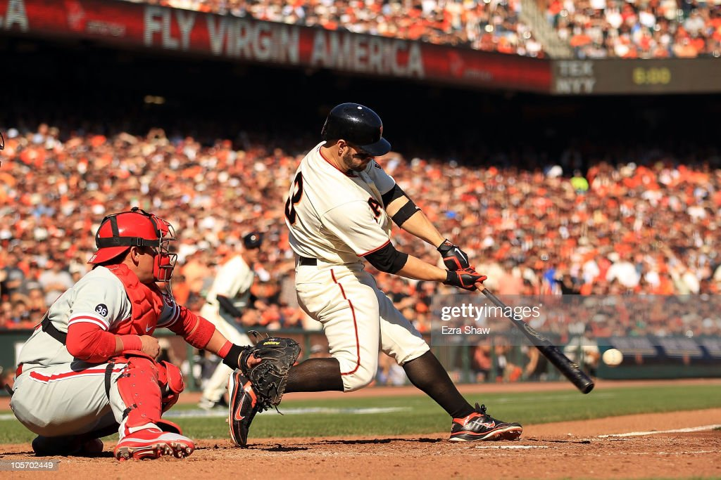 <a gi-track='captionPersonalityLinkClicked' href=/galleries/search?phrase=Cody+Ross&family=editorial&specificpeople=545810 ng-click='$event.stopPropagation()'>Cody Ross</a> #13 of the San Francisco Giants hits an RBI single against Cole Hamels #35 of the Philadelphia Phillies in the fourth inning of Game Three of the NLCS during the 2010 MLB Playoffs at AT&T Park on October 19, 2010 in San Francisco, California.