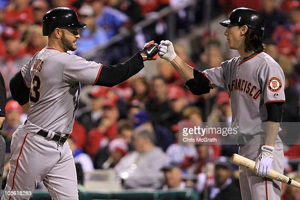 Cody Ross of the San Francisco Giants is greeted at home by pitcher Tim Lincecum after Ross hit a fifth inning home run against the Philadelphia...
