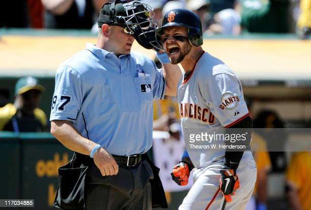 Cody Ross of the San Francisco Giants is upset with a called third strike by homeplate umpire Scott Barry that ended a MLB baseball game against the...