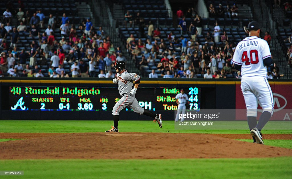 <a gi-track='captionPersonalityLinkClicked' href=/galleries/search?phrase=Cody+Ross&family=editorial&specificpeople=545810 ng-click='$event.stopPropagation()'>Cody Ross</a> #13 of the San Francisco Giants rounds the bases after hitting a home run against Randall Delgado #40 of the Atlanta Braves at Turner Field on August 16, 2011 in Atlanta, Georgia.