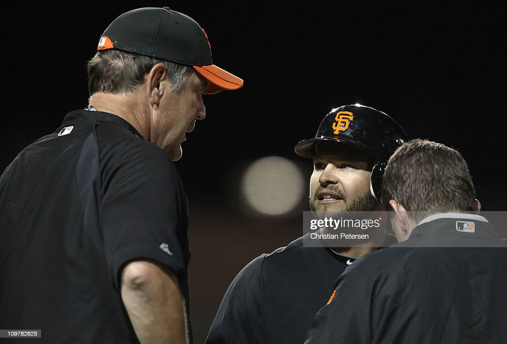 <a gi-track='captionPersonalityLinkClicked' href=/galleries/search?phrase=Cody+Ross&family=editorial&specificpeople=545810 ng-click='$event.stopPropagation()'>Cody Ross</a> #13 of the San Francisco Giants talks with manager <a gi-track='captionPersonalityLinkClicked' href=/galleries/search?phrase=Bruce+Bochy&family=editorial&specificpeople=220291 ng-click='$event.stopPropagation()'>Bruce Bochy</a> after Ross was hit by a pitch during the second inning of the spring training game against the Los Angeles Dodgers at Camelback Ranch on March 4, 2011 in Glendale, Arizona.