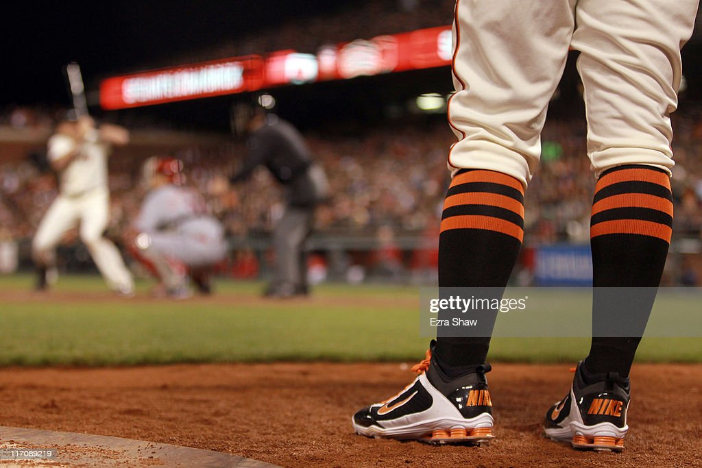 <a gi-track='captionPersonalityLinkClicked' href=/galleries/search?phrase=Cody+Ross&family=editorial&specificpeople=545810 ng-click='$event.stopPropagation()'>Cody Ross</a> #13 of the San Francisco Giants waits to bat against the Cincinnati Reds at AT&T Park on June 9, 2011 in San Francisco, California.