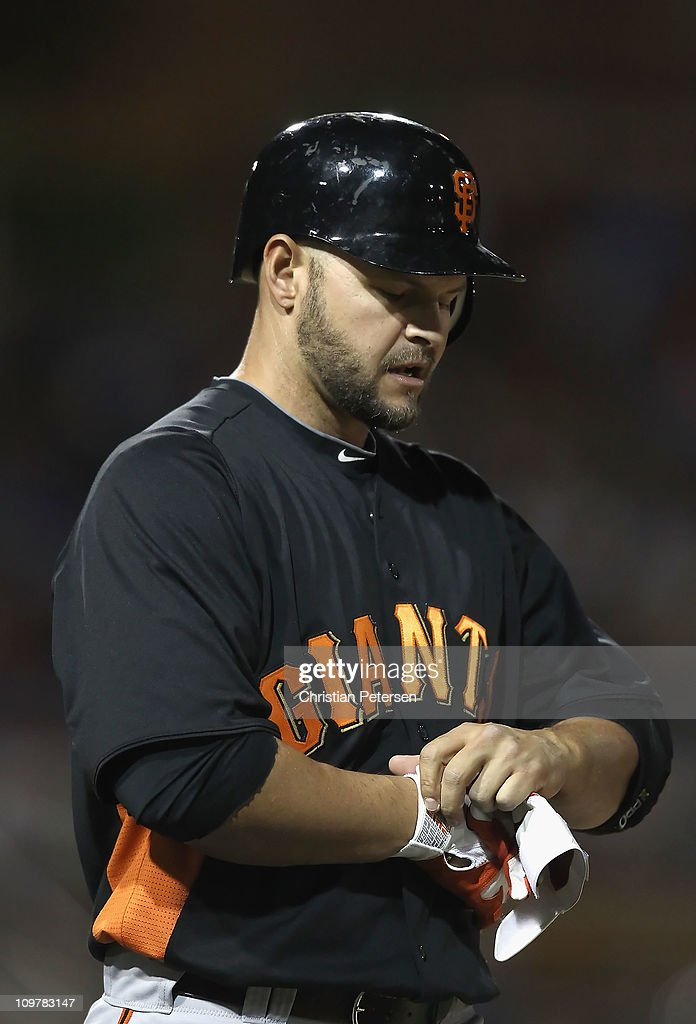 <a gi-track='captionPersonalityLinkClicked' href=/galleries/search?phrase=Cody+Ross&family=editorial&specificpeople=545810 ng-click='$event.stopPropagation()'>Cody Ross</a> #13 of the San Francisco Giants walks to first base after being hit by a pitch from the Los Angeles Dodgers during the spring training game at Camelback Ranch on March 4, 2011 in Glendale, Arizona.