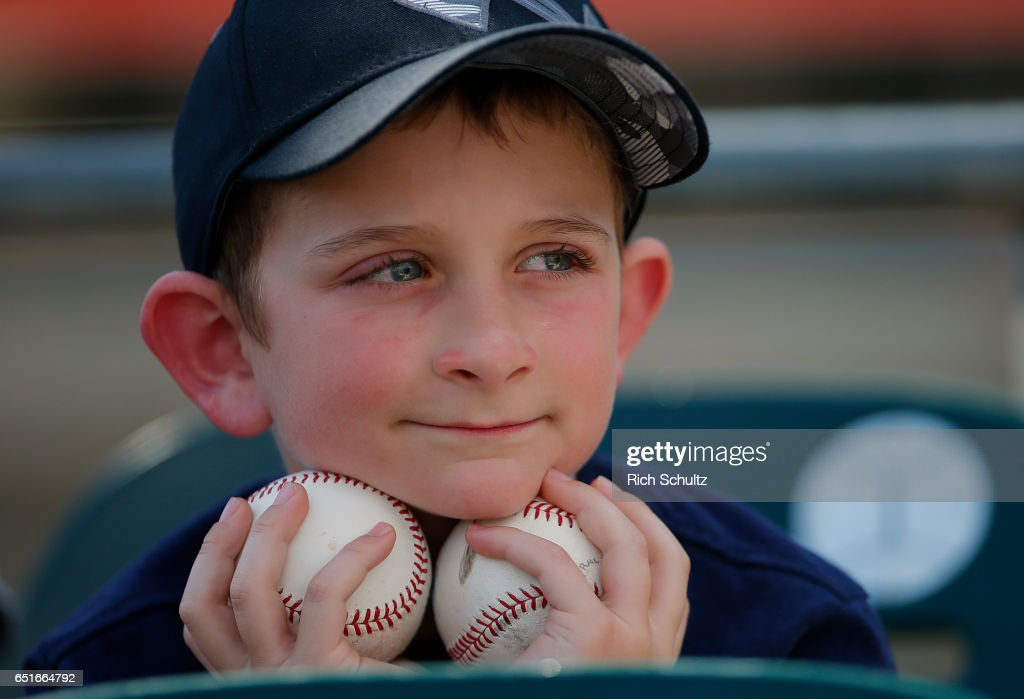 Cody Rudoy, an eight year-old from Minnesota watches batting practice before a spring training baseball game between the Minnesota Twins and the Miami Marlins at Roger Dean Stadium on March 10, 2017 in Jupiter, Florida.