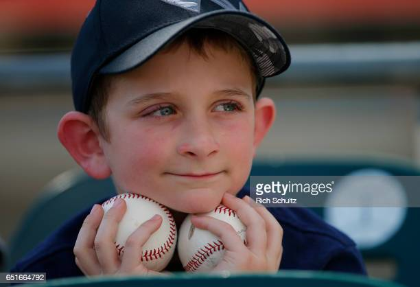 Cody Rudoy an eight yearold from Minnesota watches batting practice before a spring training baseball game between the Minnesota Twins and the Miami...