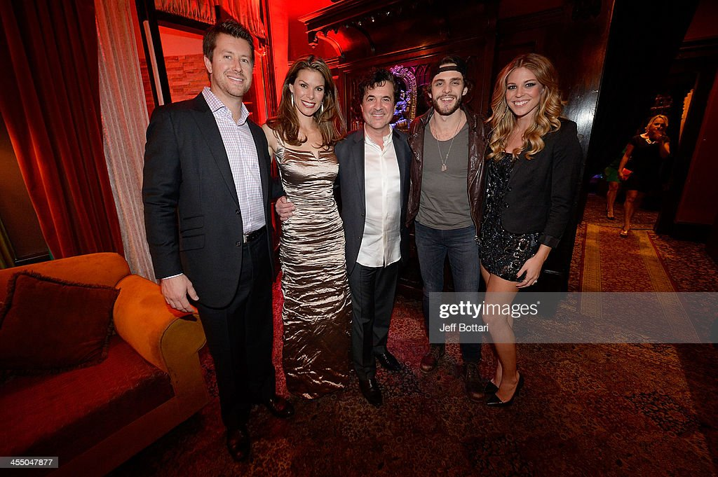 Cody Selman, NASCAR reporter Jamie Little, Big Machine Label Group President and CEO <a gi-track='captionPersonalityLinkClicked' href=/galleries/search?phrase=Scott+Borchetta&family=editorial&specificpeople=4462508 ng-click='$event.stopPropagation()'>Scott Borchetta</a>, country music artist <a gi-track='captionPersonalityLinkClicked' href=/galleries/search?phrase=Thomas+Rhett&family=editorial&specificpeople=9092574 ng-click='$event.stopPropagation()'>Thomas Rhett</a> and his wife Lauren attend the Big Machine Label Group Crown Royal after party for the American Country Awards 2013 at the House of Blues Las Vegas Foundation Room inside the Mandalay Bay Resort and Casino on December 10, 2013 in Las Vegas, Nevada.
